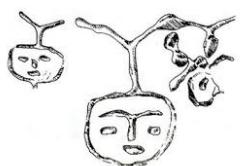 Hình 2. Hình mặt người khắc trên vách hang Đồng Nội (Hòa Bình)